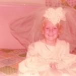 Dressing up in Mom's wedding dress 1
